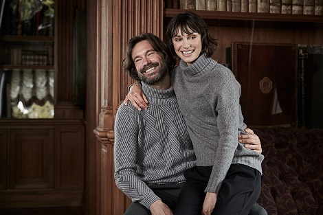 Paolo wears our vanisè cashmere turtleneck, Beatrice wears our wool blend turtleneck with bright lurex detail